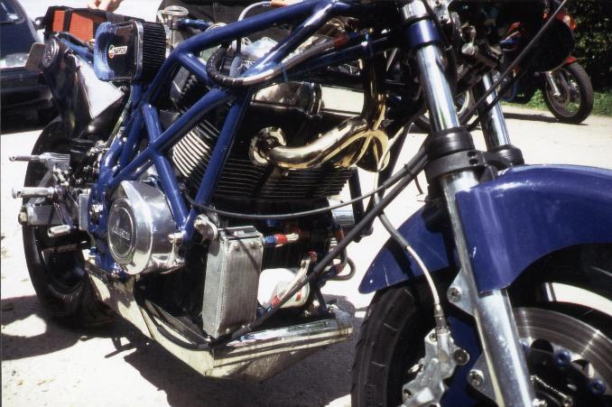 pipes lead upwards over the engine